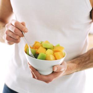 man-eating-bowl-of-fruit-photo-420x420-ts-57448234